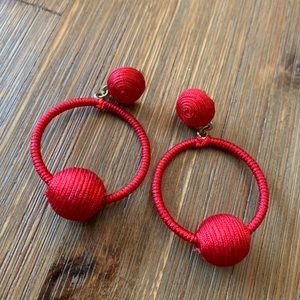 Express red thread & ball dangle hoop earrings
